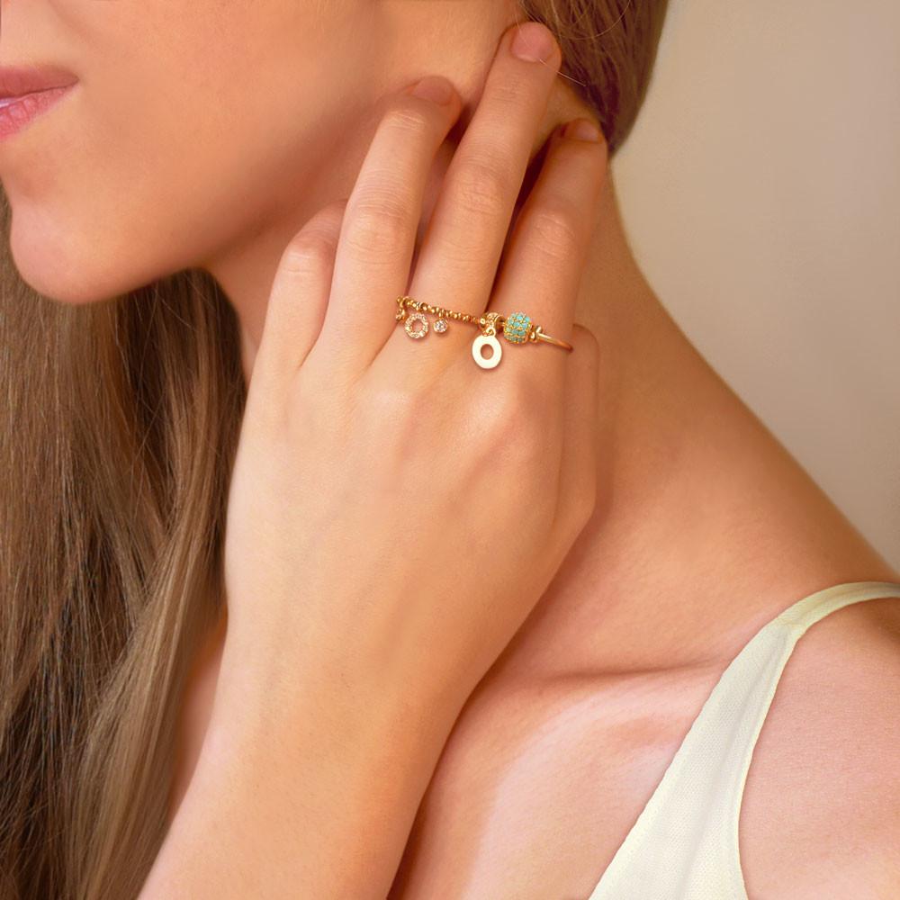 Pierścionek złoty z wiszącym elementem i cyrkoniami, próba 585